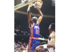 John Salley signed Detroit Pistons 8x10 Photo (blue jersey)