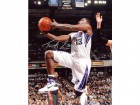 Tyreke Evans Autographed / Signed Vs. Miami Heat 8x10 Photo