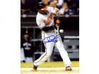 Adam Jones Autographed / Signed Hitting the Ball 8x10 Photo