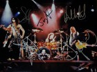 Aerosmith Signed - Autographed 11x14 inch Photo - Guaranteed to pass PSA or JSA - signed by Steven Tyler, Tom Hamilton, Joey Kramer, Brad Whitford, and Joe Perry