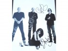 Garbage Signed - Autographed 11x14 inch Photo - Guaranteed to pass PSA or JSA signed by Shirley Manson, Duke Erikson, Steve Marker, and Butch Vig