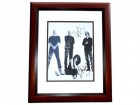 Garbage Signed - Autographed 11x14 inch Photo MAHOGANY CUSTOM FRAME - Guaranteed to pass PSA or JSA signed by Shirley Manson, Duke Erikson, Steve Marker, and Butch Vig