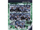 Seattle Seahawks Signed 8x10 By the 2006 Seattle Seahawks: Marcus Truffant, Grant Wistrom, Bobby Engram, Nate Burleton, Mack Strong, Lofa Tatupa, Jerramy Stevens, Darrell Jackson, Matt Hasselbeck, and Shaun Alexander. In total, 10 signatures.